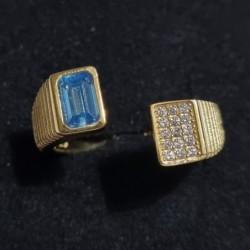 Tris di anelli in ottone...